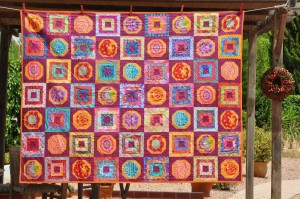 'Magenta and golden flowers' quilt